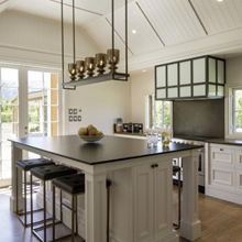 A wide shot of a kitchen with a custom joinery island.